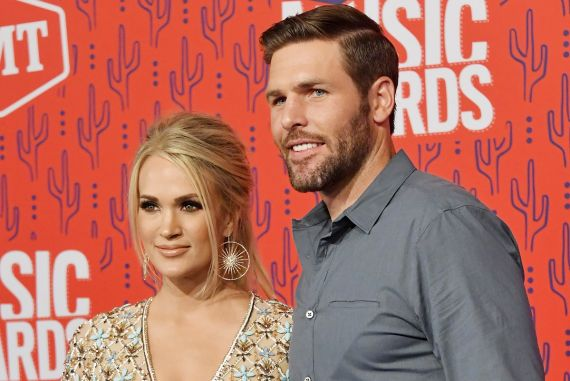 Carrie Underwood and Mike Fisher; Photo by Mike Coppola/Getty Images for CMT