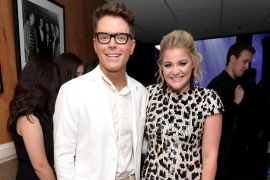 Bobby Bones, Lauren Alaina; Photo by Jason Kempin/Getty Images for Academy of Country Music