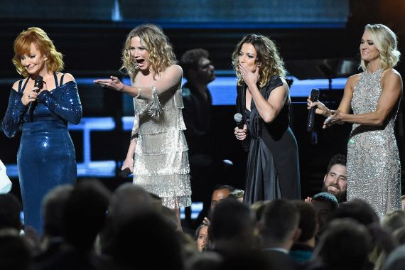 Reba McEntire, Jennifer Nettles, Martina McBride, and Carrie Underwood; Photo by Gustavo Caballero/Getty Images