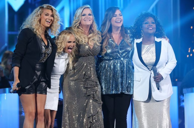 "Trisha Yearwood (center) performs ""Children Go Where I Send Thee"" with (L – R) Tori Kelly, Kristin Chenoweth, Hillary Scott and CeCe Winans during ""CMA Country Christmas""; Photo by Hunter Berry/CMA"