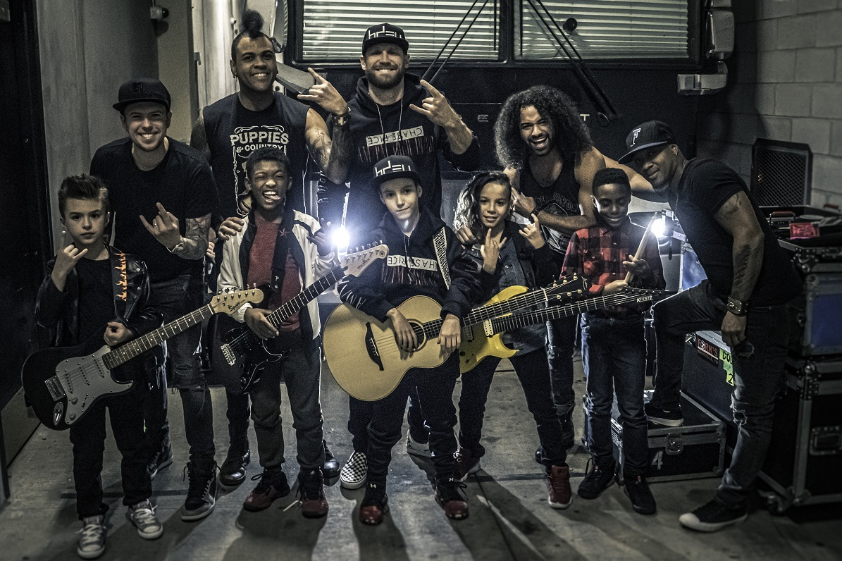 "Chase Rice & bandmates (back row L to R: Chris Loocke/lead guitar, Marcelo Bakos/bass, Rice, John Souki/rhythm guitar, Jeremy Roberson/drums) pose backstage with the young stars of the ""Lonely If You Are"" official music video 